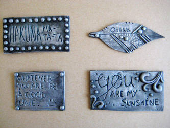 Faux metal polymer clay quote magnets by RoyalKitness