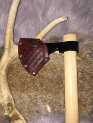 Leather axe cover by TheGuildedPlane