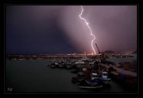 Flash of lighting on the city by Patguli