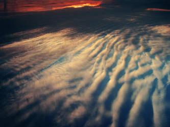 Surfing Sky by Kostandina