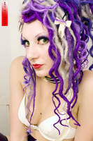 purple curly dreads by biomechanina