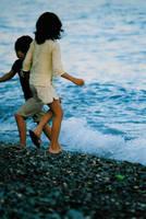 Children on the beach by sunnie