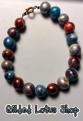 Beaded Bracelet by GildedLotusShop
