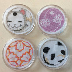 Cross stitched coasters by Awenmir