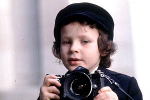 Damien Thorn...with a camera?! by MothraLeo