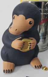 Niffler piggy bank by Cosmicmoonshine