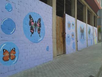 Nena con bolboretas by Patuco