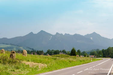 Tatra mountains in sunlight by vertiser