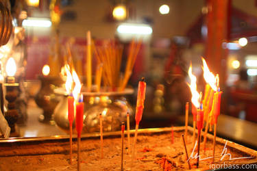 Burning candles detail at Man Mo temple, Hong Kong by kaitou-ace