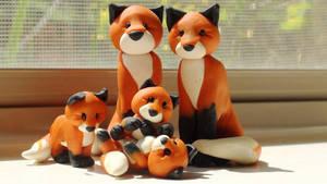 Fox Family by rivertiger77