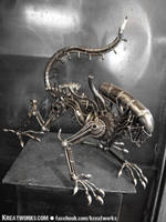 The Metal Crouching Alien by Kreatworks