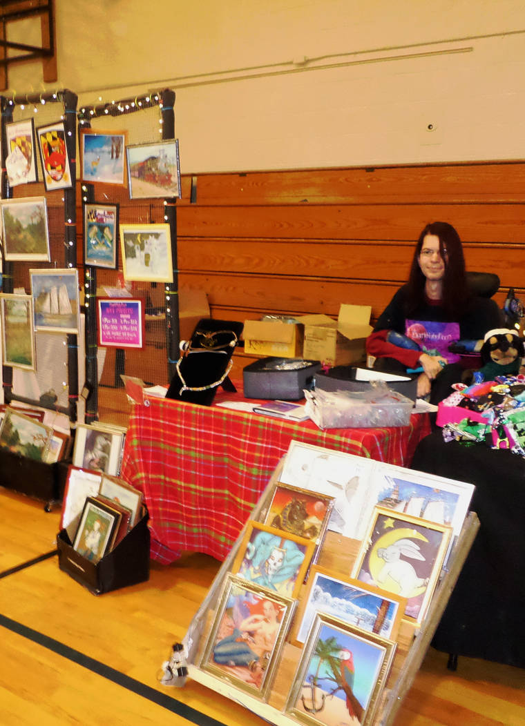 Picture of me not selling anything at art show by DarkRubyMoon