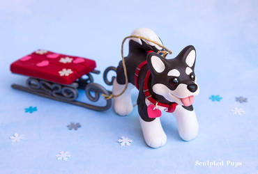 Malamute puppy with a sled by SculptedPups