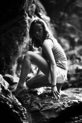 Crouching on Rocks by escaped-emotions