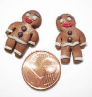 Gingerbread man earrings by FelineArtisan