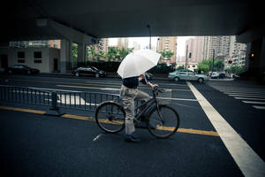 Cycling in the rain by Gregos