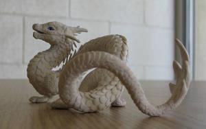 Blue-eyed gift dragon by tallydragon