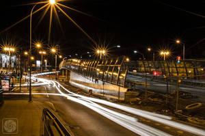 Busy street by night by parsek76
