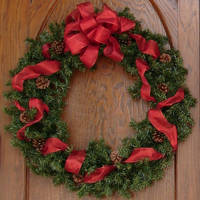 Red Bow Christmas Wreath by FantasyStock