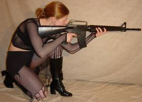 Jodi Black Fishnet Aims Rifle by FantasyStock