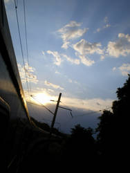 Sunset from the train by lorkata