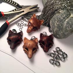 Wooden wolf pendants by JonasOlsenWoodcraft