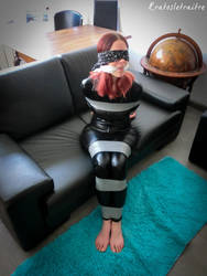 Taped in Catsuit on Sofa by Kratosletraitre