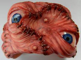 Eye stitches cuff by dogzillalives