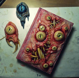 Necronomicon sketchbook 5/28 and some pendants by dogzillalives