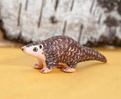 Pangolin polymer clay totem by lifedancecreations