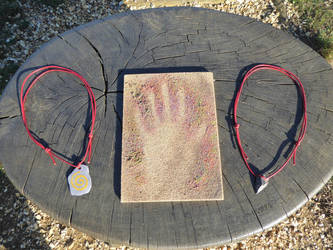 Stone Age pendants and hand stencil by artjuggler