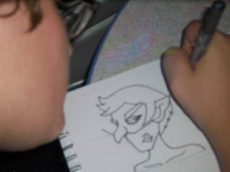Me working on Comic page by Mephonix