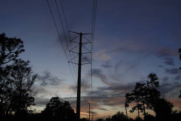 Towering Sunset by LaMoonstar
