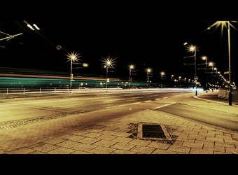 The traffic on a bridge at night by Nielio