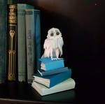 Miniature Owl on Books by wetcanvas