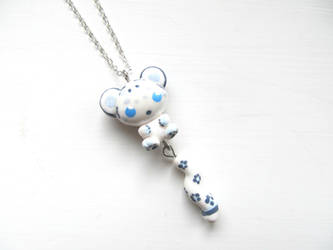Snow Leopard Necklace by DapperLittleMagpie