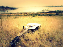 Guitar taking Sun Bath by SuyogJain