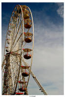 Big Wheel And Blue Sky by TakeMeToAnotherPlace