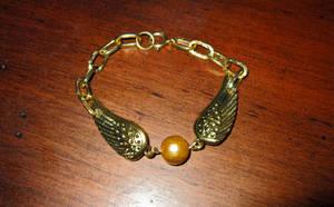 Harry Potter Golden Snitch Bracelet by wingedlight