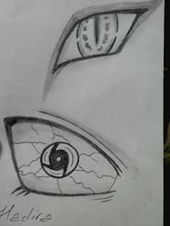 Eyes of Itachi and Orochimaru by hadira
