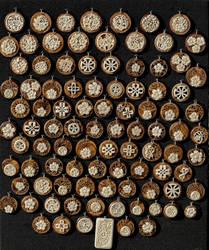 bone medallions on olive tree wood  1 by manuroartis