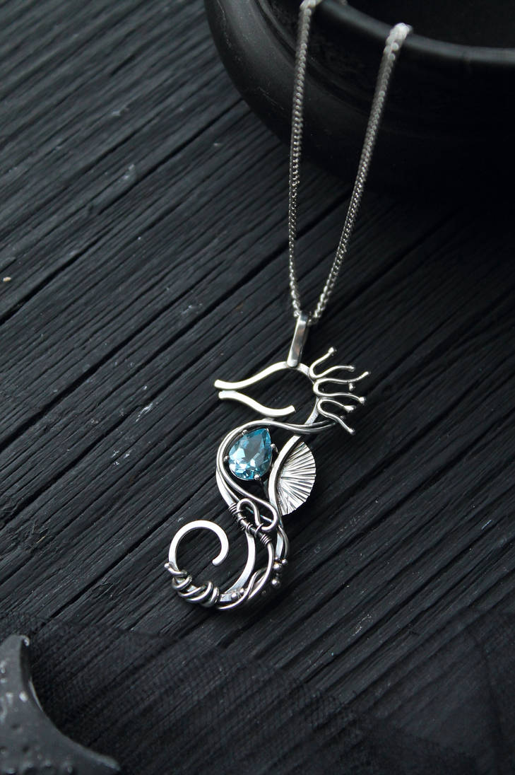 Seahorse with blue topaz by UrsulaJewelry