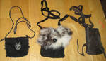 Three custom necklace pouches by lupagreenwolf