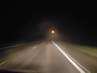 Dark and foggy road by sequential