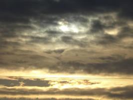 Sun peaking through the clouds by GraceElisabet