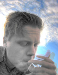 Lighting a cigarette.. by Creadion