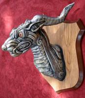 Silver creature head by missmonster