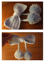 baby blue hair-bow with pom poms by theyarnbunny