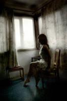 a quiet is in a window. by ann-ko