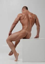 Stock nude man on cube by vishstudio
